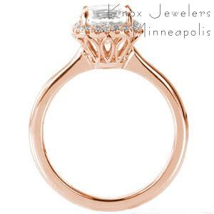 Rose gold custom engagement ring in Raleigh with a cushion cut center diamond surrounded by a diamond halo.