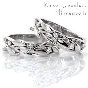 These romantic bands are alluring with the gentle motion of the leaves and vines that create the design. The bands can be worn many ways and can be used to accent a beautiful engagement ring. There are small round brilliant cut diamonds nestled among the leaves for an added touch of glamor.
