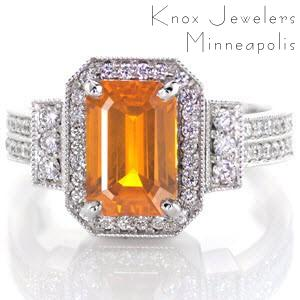 Vibrant hues from the 2.00 carat emerald cut orange sapphire make this ring stand alone. Set in a 14k white gold art deco band with classic prongs, the sapphire takes center stage. All edges are adorned with milgrain detail to frame the round cut bead set diamonds for a delicate touch.