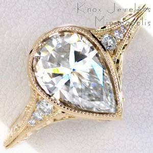Honolulu Hawaii unique wedding ring. Shown in yellow gold with pear shape diamond..