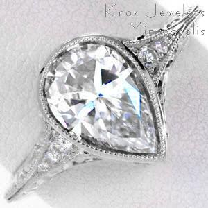 Antique engagement ring in Fresno with hand engraving, milgrain and pear shape center stone.