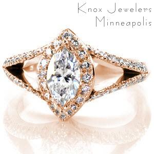 Custom rose gold split shank engagement ring in Providence. This marquise cut diamond engagement ring features a micro pave diamond halo and split shank band. The basket under the halo features hand formed filigree in delicate curls.