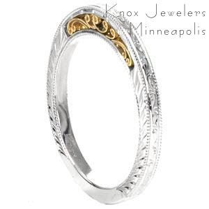 Unique antique wedding band in Chicago. This delightful band is shown as a two tone with a while gold band and yellow gold filigree. Three sides of the band are also detailed with hand engraving and milgrain.