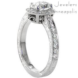 Halo engagement ring in McAllen with oval center stone, hand engraving and scroll filigree.