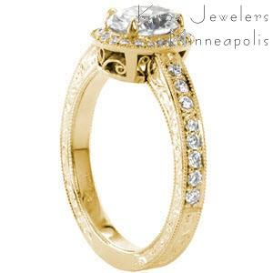 Filigree engagement ring in Cleveland with oval center stone, hand engraving and diamonds.