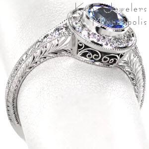 Sapphire engagement ring Davidson County. Shown Design 2591 featuring bezel set sapphire, halo and filigree accents.