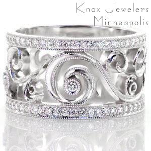 Schenectady custom wide band ring with bead set diamond rails bordering a central scroll pattern design with bezel set stones.