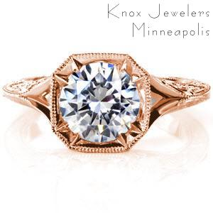 Baltimore engagement ring in rose gold with round center stone and engraved band.