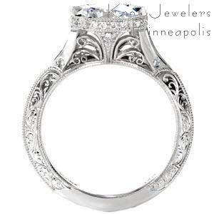 Antique engagement ring in Memphis with hand engraving, filigree and diamonds.