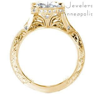 Antique yellow gold engagement rings in Winnipeg with exquisite hand engraving, delicate filigree curls, and diamonds. This unique halo engagement ring is one of a kind!