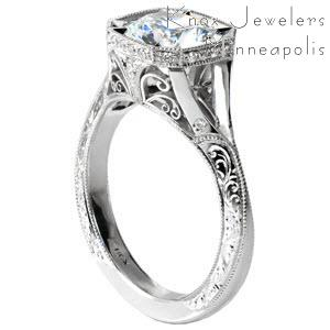 Stunning split shank engagement ring in Raleigh is an antique engagement ring design with hand engraving and filigree. Unique halo style and flush set diamonds on the band.