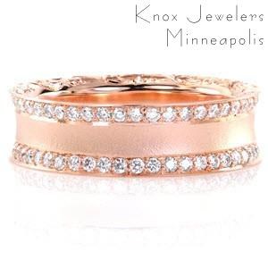 This glamorous concave diamond band is featured in a lovely 14k rose gold metal. Curved edges are decorated with hand engraved scroll-work for a picturesque view. Two rows of bead set diamonds line the top of the ring for brilliance. The sandblasted finish adds a chic texture along the center of the design.