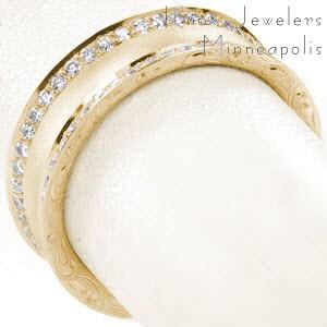 Beautiful wide wedding bands with scroll patterned hand engraving and micro pave diamonds in Honolulu.