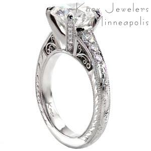 Custom engagement ring with a round diamond center held by four diamond set prongs with a band including bead set diamonds, hand engraving, milgrain and filigree curls in Phoenix.