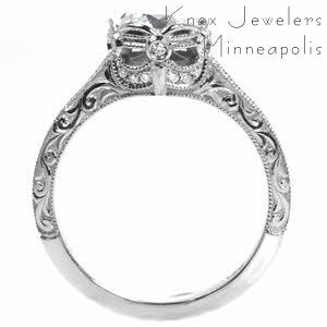 Custom engagement ring in Orlando with relief scroll engraving and bezel set center stone.
