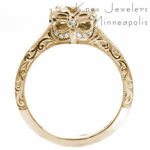 Unique Engagement Rings in Raleigh with stunning relief style hand engraving in scroll patterns. The basket of the center setting has a regal air, and is set with diamonds.
