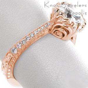 Rose gold engagement ring in Las Vegas with round center stone, micro pave diamonds and hand engraving.