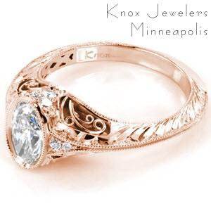 Filigree engagement ring in St. Cloud with oval center stone and half wheat engraving.