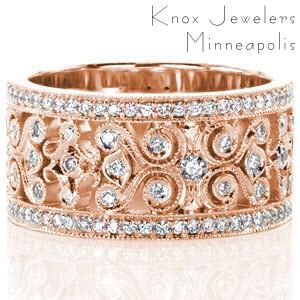 Unique wedding ring in Charleston. This wide wedding band features a vintage style filigree pattern that is edged with milgrain and set with small brilliant diamonds. This rose gold wedding band has micro pave diamond rails highlighting the intricate custom pattern in the middle of the design.