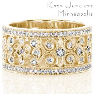 Yellow gold wedding band in Houston with micro pave diamonds and intricate pattern.