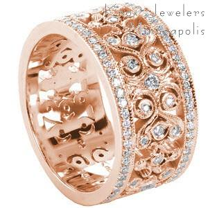 Custom rose gold wide band with bead set diamond rails and scroll patterning in Columbus.
