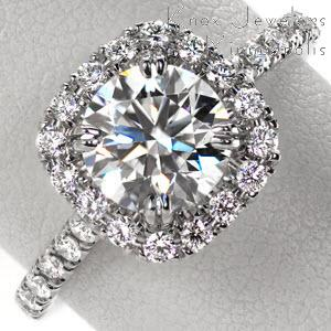 Hastings halo engagement ring with cushion shaped halo with round brilliant center stone.