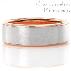 The modern and timeless look of this band offers clean lines and contrasting warm and cool tones. Fabricated in 14k rose gold and platinum, this design features soft high polish edges along with a satin finish center. This two tone look adds a unique quality to this classic design.