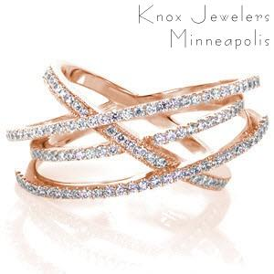 Memphis wedding band in rose gold with crisscrossing diamond bands.