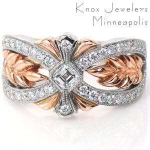 This breathtaking wide band is hand crafted in 14k white and rose gold. The flowing white bands of micro pavé lead the eye toward the asscher cut diamond center. Sprigs of high polished rose gold leaves fill the wide pockets in a warm contrast to the dazzling sparkle of the white diamonds.
