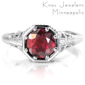 The vivid 1.50 ct. red ruby is showcased in a unique octagonal setting and is held in place with eight bead set prongs for security and detail. Pierced patterns are accented in milgrain texture and a smooth high polish for a striking contrast. The hand engraved wheat pattern adds to the antique feel or this design.