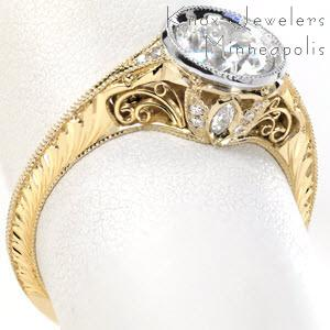 Antique bezel set diamond engagement rings in Omaha feature intricate vintage inspired details. Gorgeous two-tone engagement ring features a platinum center setting on a yellow gold ring. The knife edge band, hand engraving, and hand formed filigree curls really take this diamond ring to the next level!