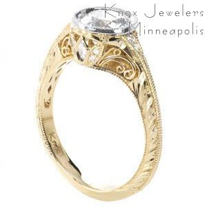 Custom two tone engagement ring in Albany with a center bezel set diamond and filigree and hand engraving band details.