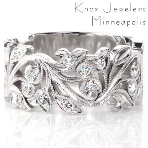 Design 2837 is a gorgeous wide band formed from gracefully intertwining leaves and vines. Small diamonds are set among the the leaves on the top section of the band to add flashes of radiant light. All of the edges are carefully hand detailed with milgrain texture.