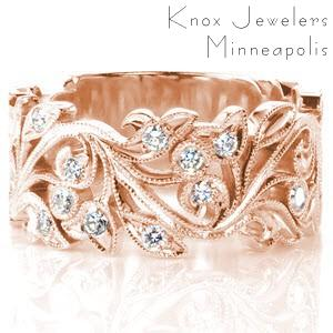 Unique wide wedding band in Denver features an antique inspired floral design. This beautiful rose gold wedding band is edged with a beaded milgrain texture and is set with brilliant round diamonds.