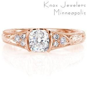 Antique engagement ring in Quebec with a cushion cut center stone set in a half bezel.