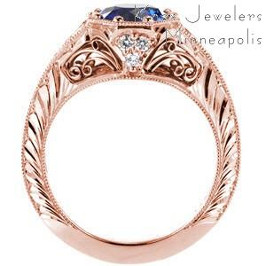 Charleston custom rose gold engagement ring with a knife edge band and octagonal central bezel holding a round blue sapphire.