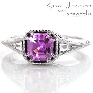The milgrain knife edge flares to the top of the ring to meet the decorative octagon setting. The asscher cut purple sapphire is fashioned in a double prong on each corner. Tapered baguettes accent the split of the knife edge on either side of the center. Filigree, hand engraving and round diamonds adorn the sides.