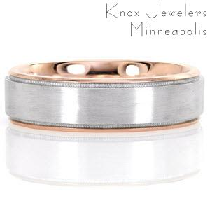 With the warm hue of 14k rose gold, Denver is a modern styled band of sophistication. The design is crisp and unique with a 14k white gold center with brushed finish. Merging the transition between golds, hand applied milgrain unites the design.