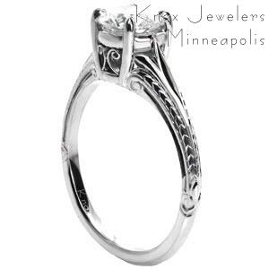 Solitaire engagement rings in Portland with custom hand engraving and hand formed filigree curls.