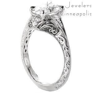 Oval diamond engagement ring with filigree