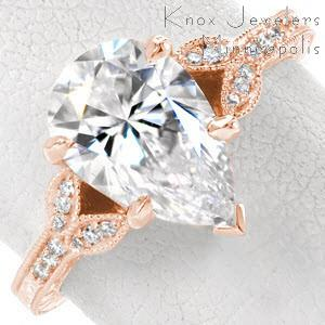 Rose gold engagement ring in Massachusetts with pear center stone, hand engraving and milgrain.