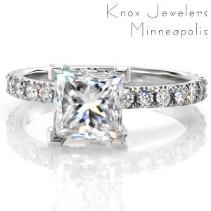 Unique engagement ring with princess cut center stone and diamond band in Memphis.