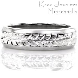 This hand engraved men's band is featured in 14k white gold with high polished, beveled edges. The middle of the band has been masterfully hand engraved with a full wheat pattern. The engraved lines are used to create depth and movement in the design. This design can be customized with a different engraving pattern.