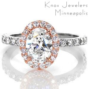 This dazzling two tone design displays a 1.25 carat oval center set inside a brilliant  micro pavé halo. The rich warm color of the rose gold makes the white of the diamonds stand out. The white gold band is also set with vibrant diamonds that compliment the halo.