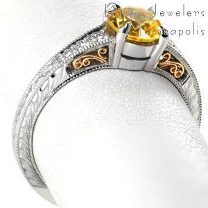Unique yellow sapphire two tone engagement ring in Milwaukee. This vintage engagement ring style is stunning with a yellow sapphire center stone and yellow gold filigree curls.