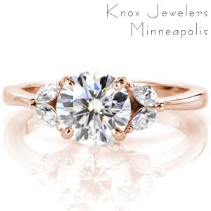 Rose gold engagement ring in Dayton with round center stone and diamond marquise-shaped petals.