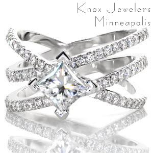 This beautiful wide design features three interwoven bands that vary in height and angle. The 1.00 carat princess cut center diamond is kite set with chevron prongs.The three bands and the prongs of the center setting are detailed with micro pavé. This design can be customized with different metals and gemstones.