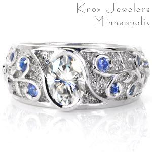 Filigree engagement ring with blue sapphires in scrolls