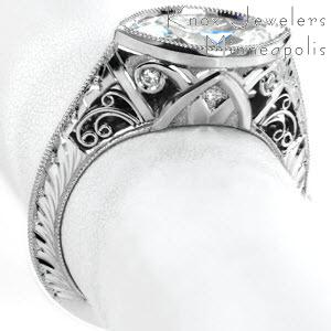 Stunning vintage engagement ring style in Cincinnati, Ohio. This Art Deco inspired piece features a marquise cut center diamond, hand engraving and hand formed filigree curls.