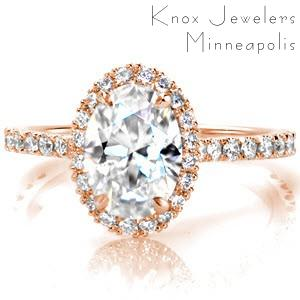 Rose gold engagement ring in Ottawa with oval center stone, diamond halo and micro pave diamonds.